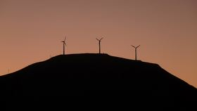 Weld Cone's three turbines at dusk